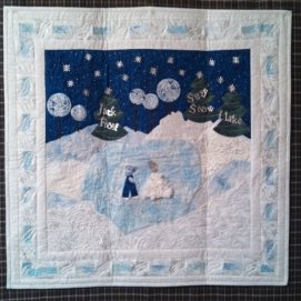 Jack Frost and Suzy Snowflake go skating. I made this for one of the Keepsake Quilting challenges.